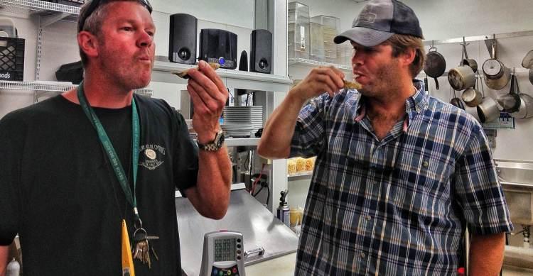 Chris & Chef Jesse slurping the Lynnhaven goodness in Eurasia's kitchen